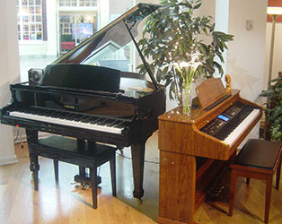 Tampa Kohler Digital Grand and used Roland Digital piano