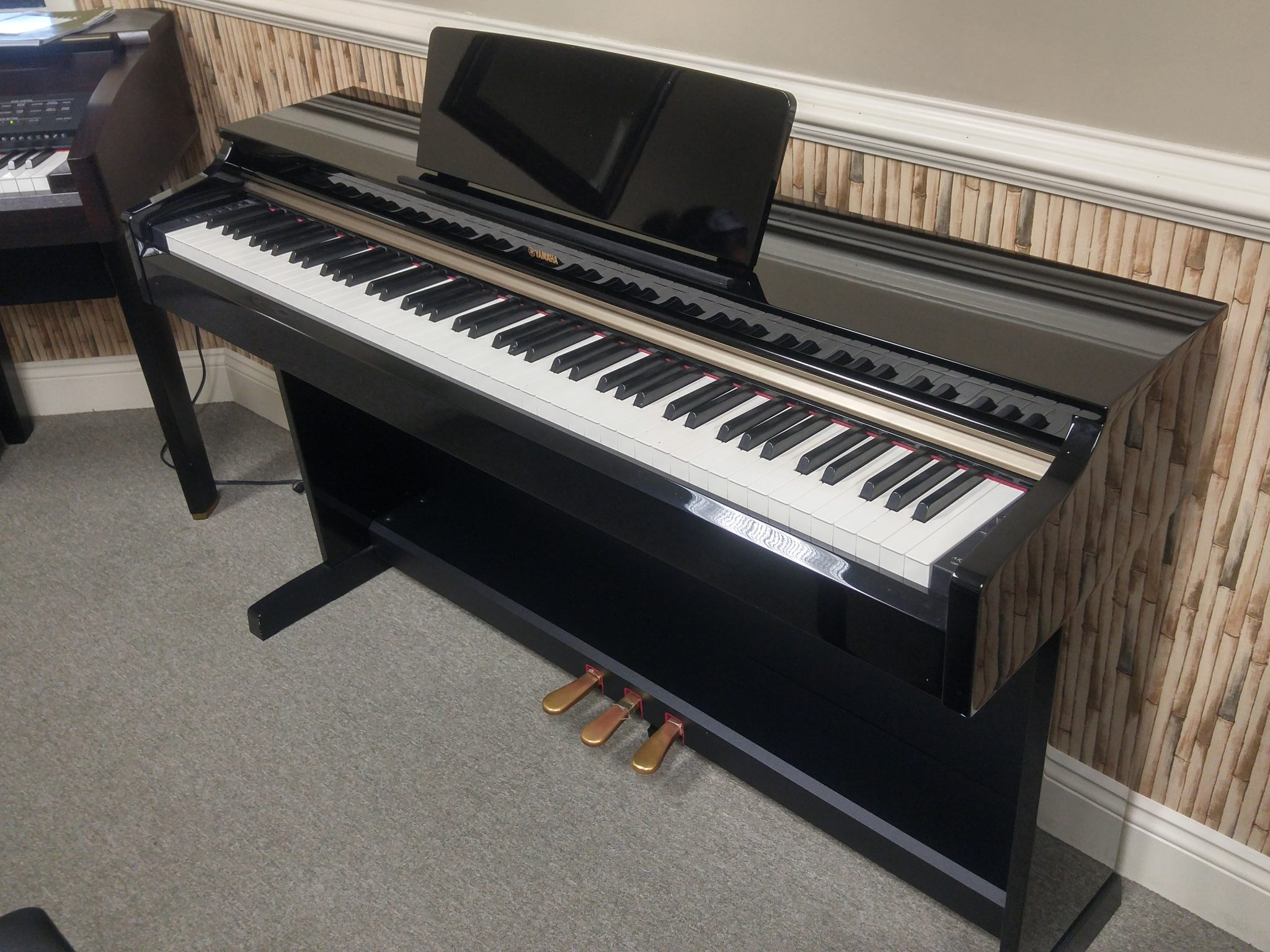 Home yamaha pianos piano distributors piano new used for Yamaha digital piano dealers