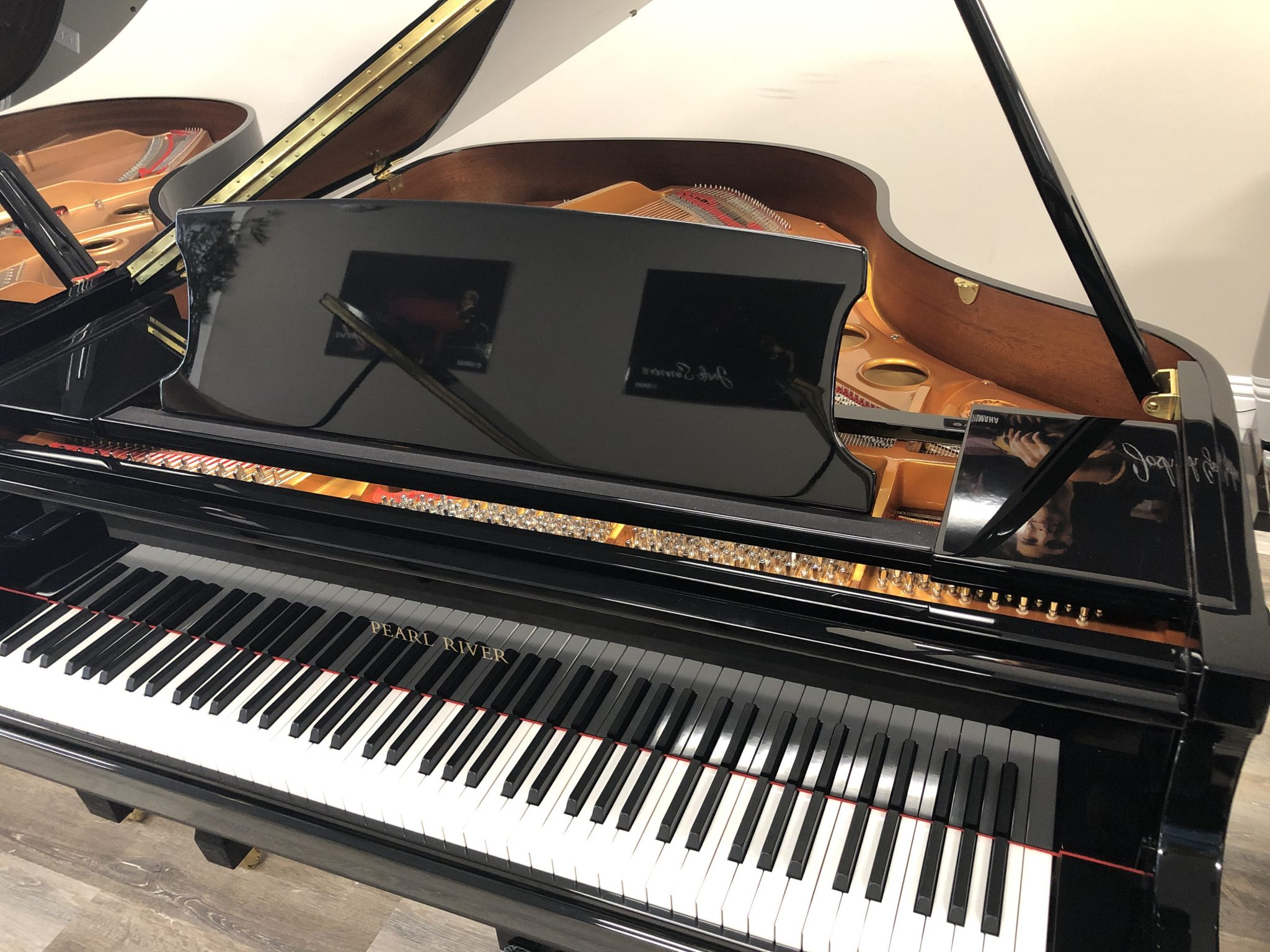Included is a QRSMusic Pianomation III player system controlled by a wireless WiFi connection. This instrument is 2 years new and a very special buy at $13,900 total!